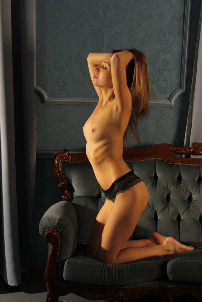 Naked model on the bed