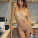 Young virgin undresses alone at home Foto Beautiful nude playboy model