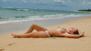 Naked top model Nicole Ross on the Nusa Dua beach, Bali