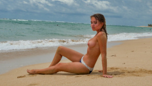 Naked top model Nicole Ross on the Nusa Dua beach, Bali
