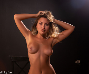 Naked young girl in the studio. Black background, back light