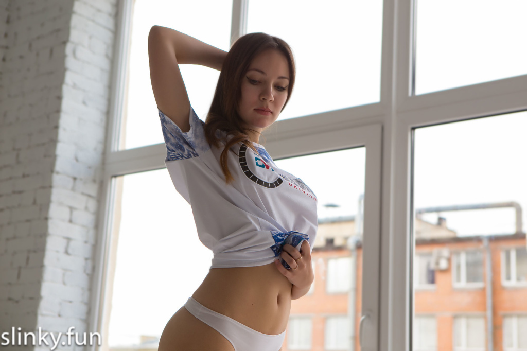 Young virgin undresses alone at home