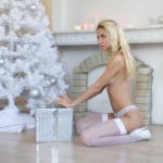 Photo nude girl - snow maiden nude with gift and Christmas tree