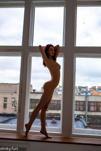 Teen naked in a photo studio
