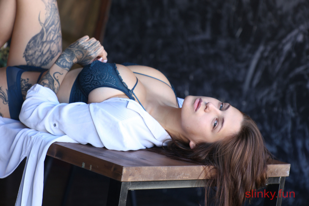 Playboy model nude Zhenya in a photo studio