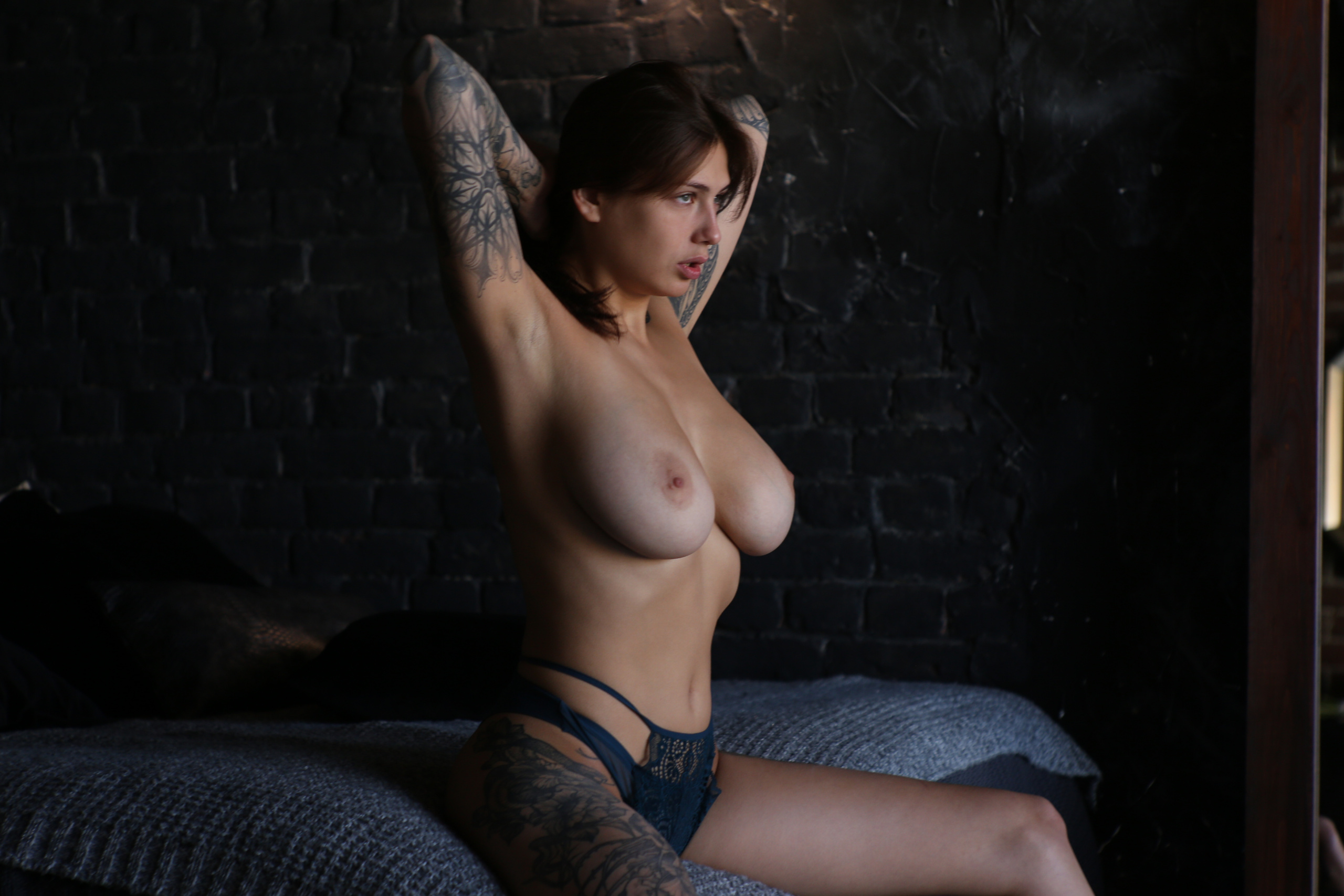 Studio portrait of tattoos on an overweight nude woman stock photo