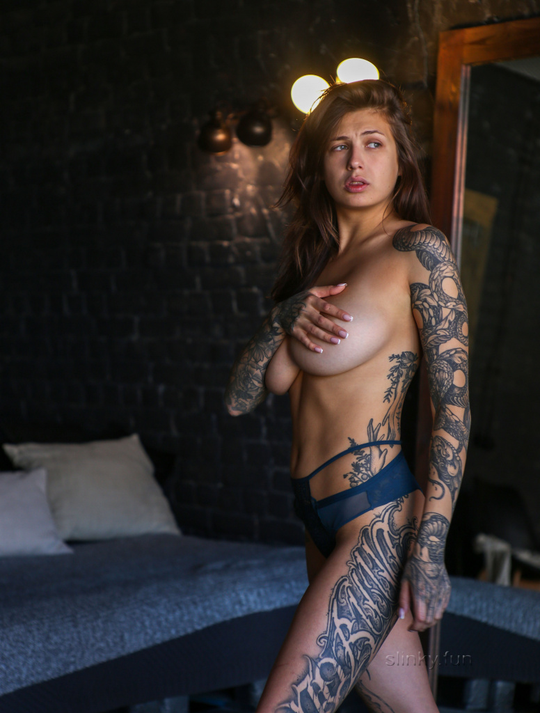 portrait of sexy nude playboy model with tattoos